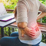 Person with pain from back strain